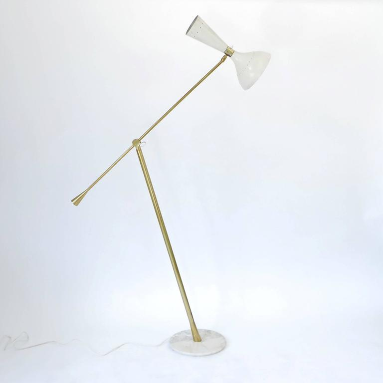 Brass adjustable single arm floor lamp with white lacquered metal shade and marble base by Arredoluce.