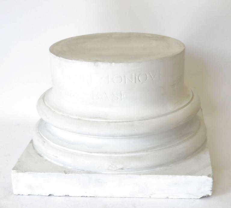 A vintage late 19th century French white plaster ionic column base used for architectural drawings classes. 