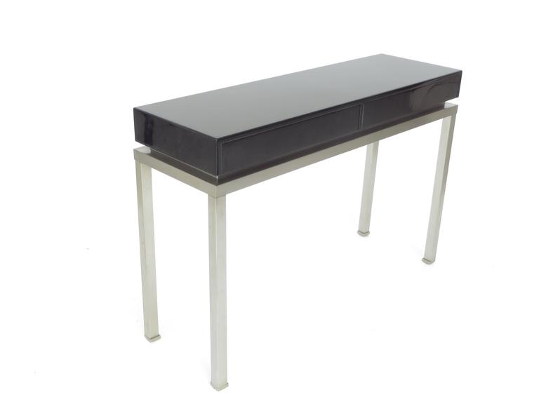 Mid-Century Modern French Black Lacquer and Brushed Stainless Steel Legs Console by Maison Jansen For Sale