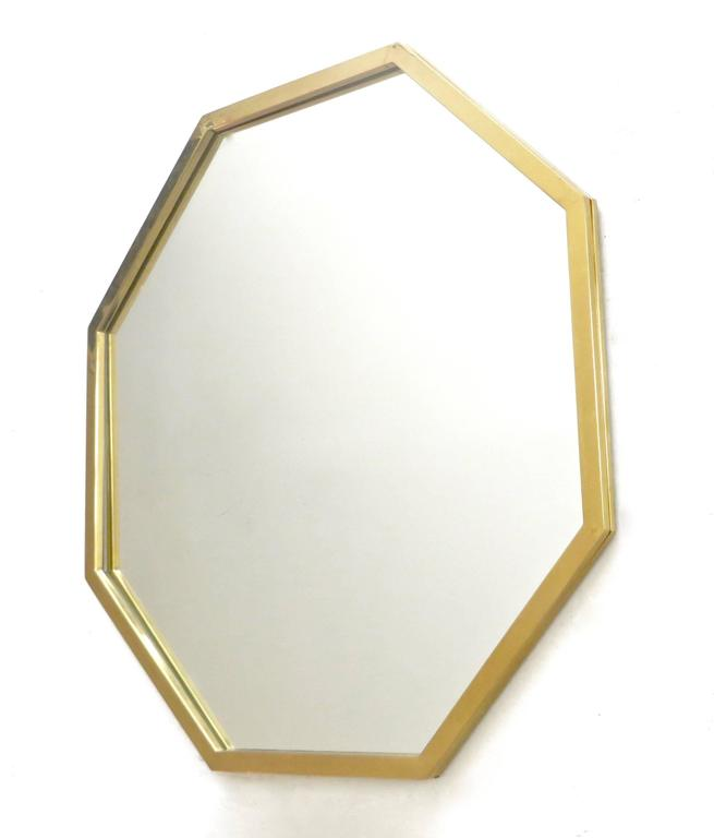 An octagonal brass framed Italian mirror with beautiful patina to the brass frame,