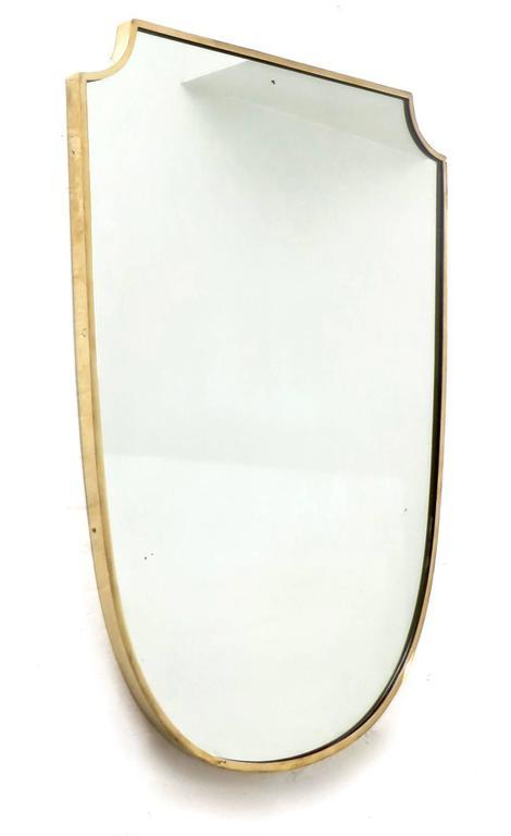 Mid-Century Modern Shield Shaped Italian Brass Framed Mirror For Sale