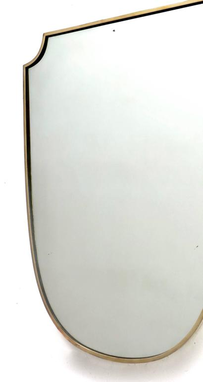 Mid-20th Century Shield Shaped Italian Brass Framed Mirror For Sale