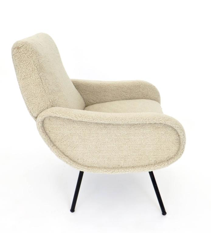 The baby Zanuso chair by Marco Zanuso for Arflex with original label intact. This chair is called the baby Zanuso but it is sized for an adult as a side chair or a desk chair or a chair for any usage.  Re upholstered recently in a furry lambswool.