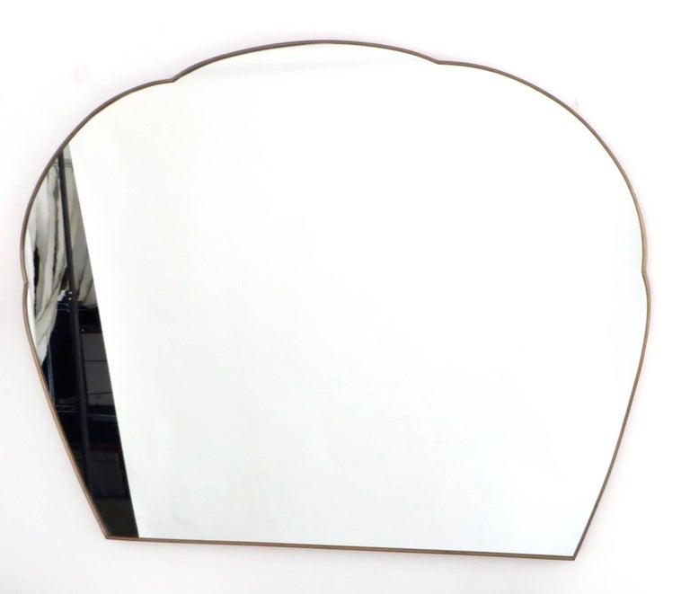 "Monumental Italian brass framed mirror, circa 1940. Soft, cloud like shape, with a flat bottom. Frame is 1.5"" deep."