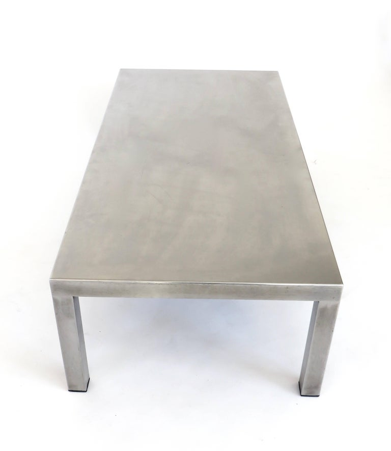 Brushed matte polished stainless steel over wood rectangular coffee table by Maria Pergay on four square steel legs created with Marina Varenne, circa 1970.