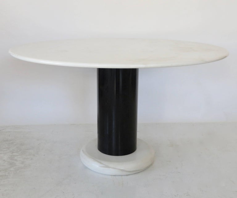 This very rare dining table Lotorosso is designed by Ettore Sottsass for Poltronova in Italy in 1965. The round top and the thick round foot are made of high quality Carrara marble. The cylindrical base is made of black lacquered metal. This model