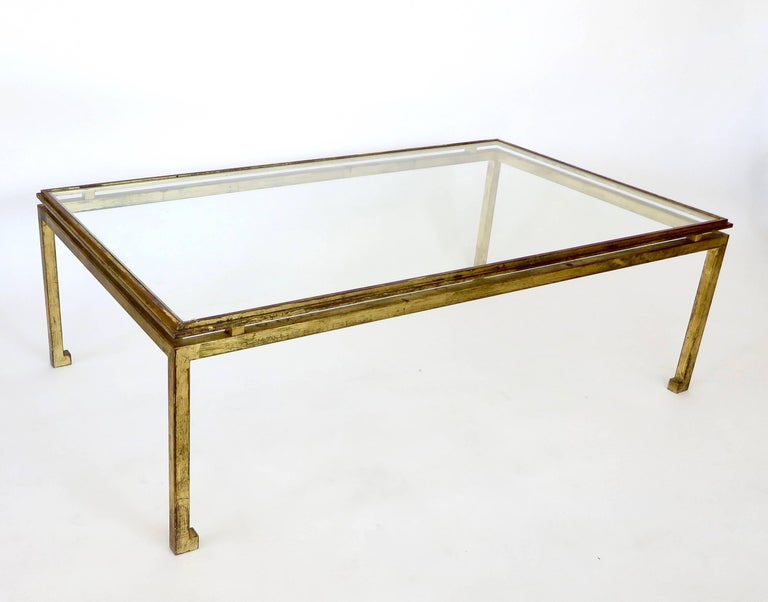 Maison Ramsay superb patina gilded wrought iron, rectangular coffee table with a St. Gobain glass plateau. See detail photo with St. Gobain glass insignia. The legs are solid iron, 1 inch thick not tubular and very heavy. Measure: The foot is 1.75