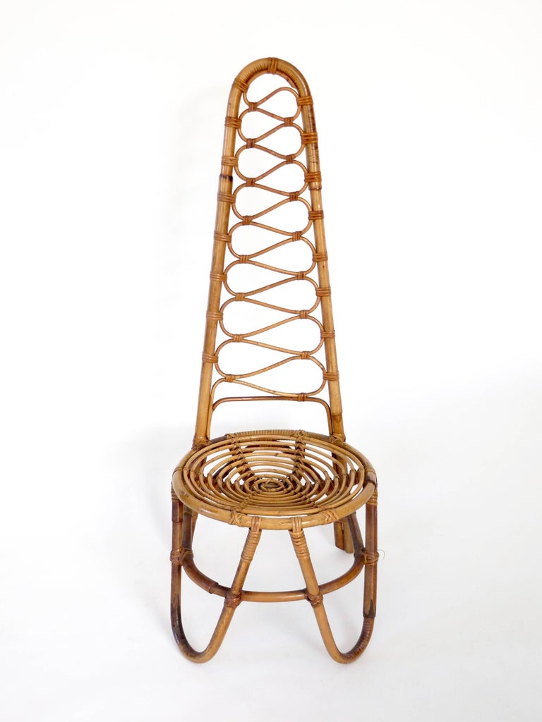A French Riviera rattan or bamboo single statement chair, circa 1960. Curved round bamboo seat and tall sculptural back, perfect for a hallway or bathroom.