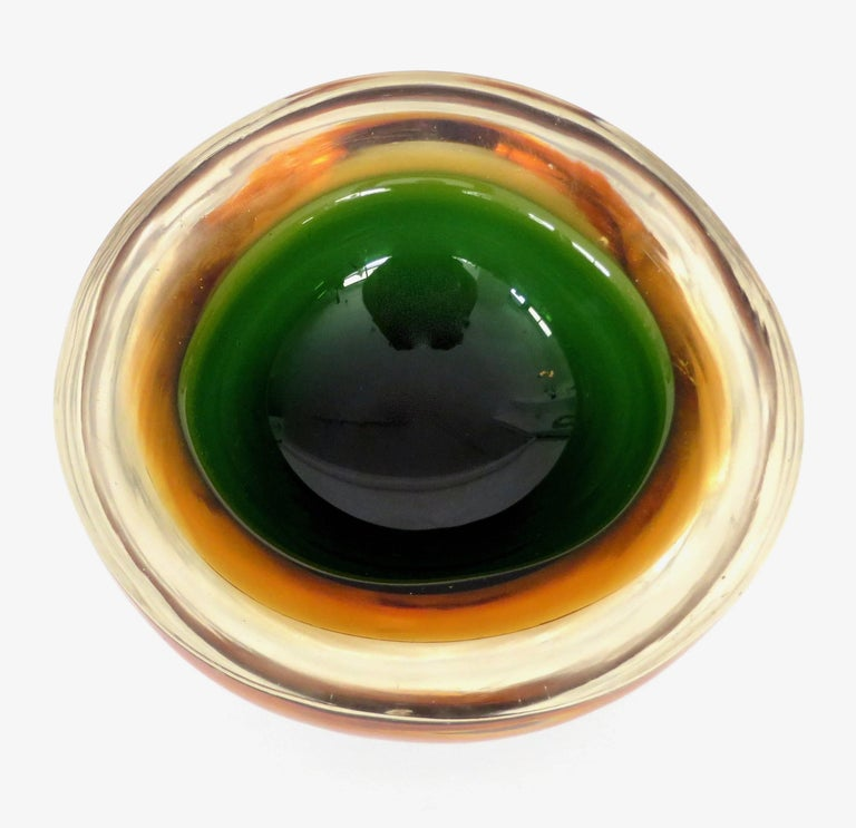 Flavio Poli Italian Sommerso Murano glass bowl in colors ranging from orange, green, green black and clear.