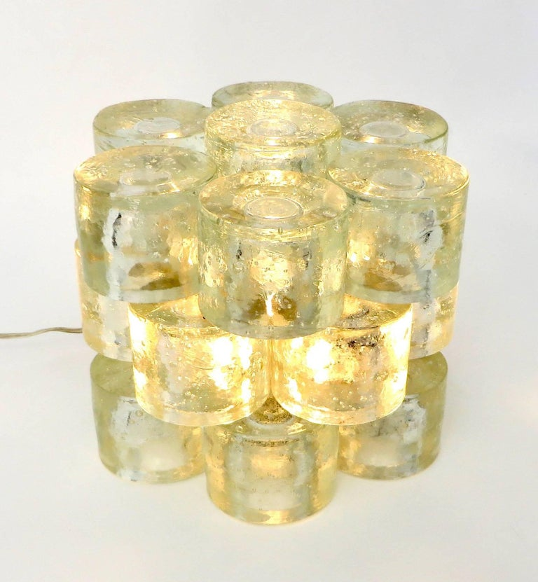 Exceptional table lamp by Poliarte, Italy, 1968.  Big and heavy piece made from stacked Murano solid round glass discs all handcrafted with each their own unique bubble pattern. Each disc is 4