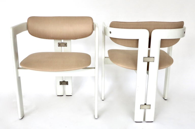 Pair of model Pamplona chairs by Augusto Savini for Pozzi, Italy, 1965. White lacquer frame with original pale pink upholstery. Chrome-plated steel details. All in the original patina. Some loss to the lacquer. Great desk or occasional chair or