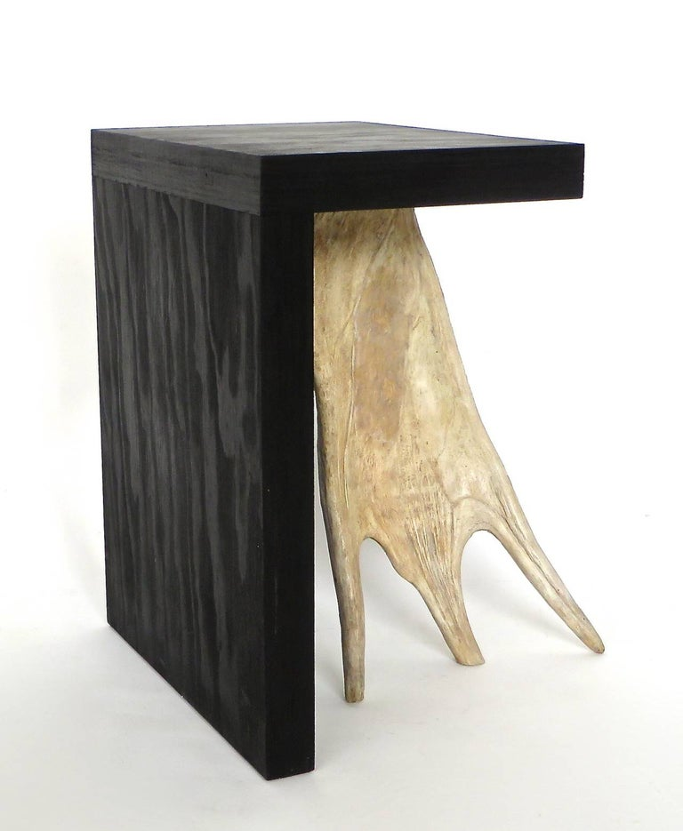 Black ebonized stained solid plywood forms with elk or moose antler. Iconic Rick Owens use of natural and organic modern materials. These are from the open edition series. Each stool is signed on the base and is a piece unique. May be used as side