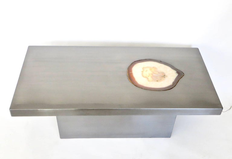 French stainless steel rectangular coffee table with a large agate inlaid into the top plateau surface with illumination from underneath.
