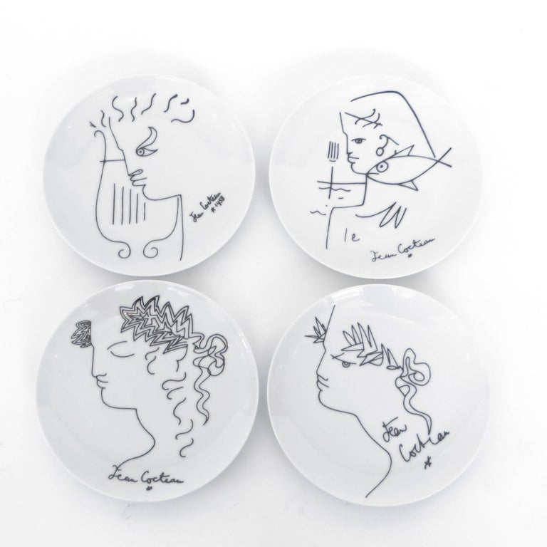 A set of four French Limoges dessert or appetizer plates by Jean Cocteau, circa 1958.