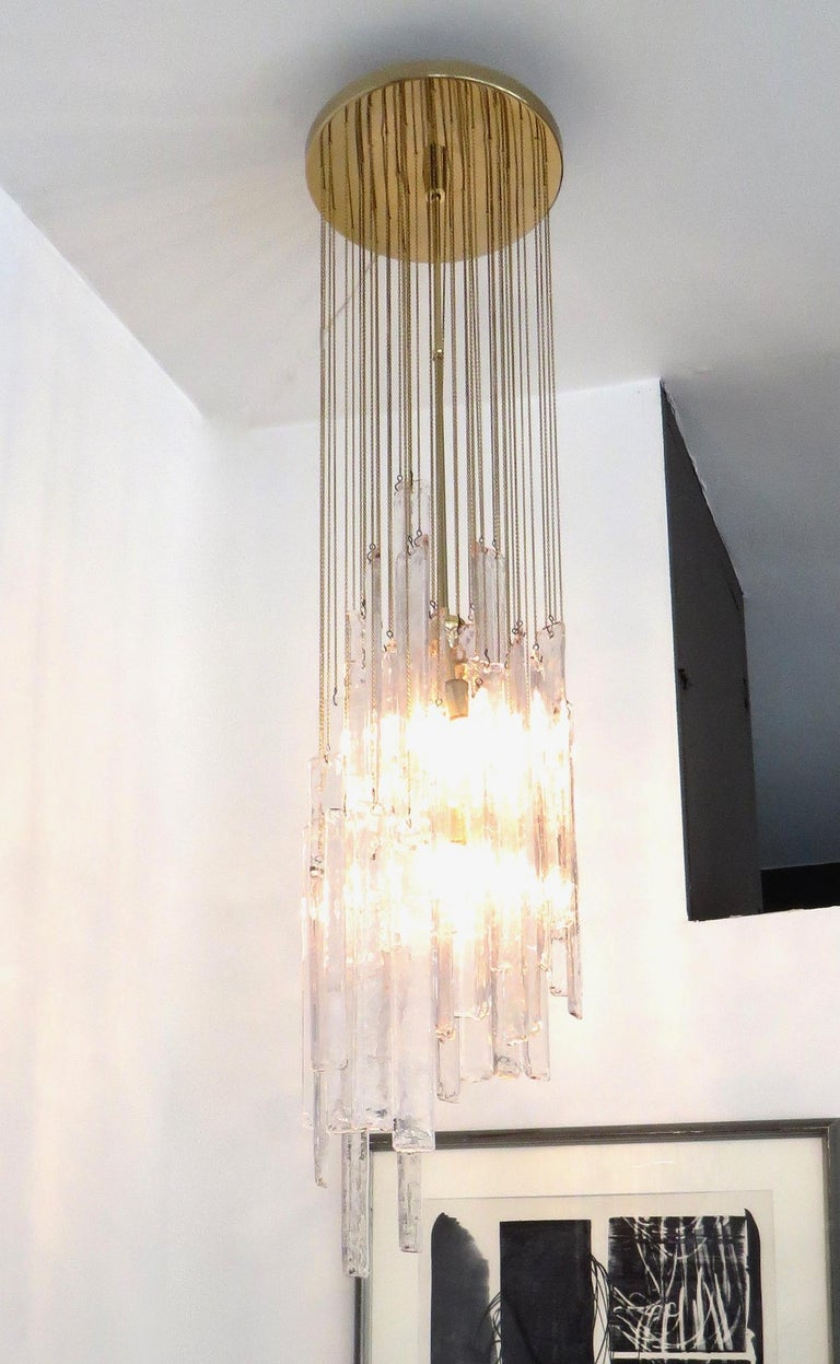 Huge and long cascade style pendant chandelier ceiling light of clear Murano glass by the manufacturer Mazzega. 