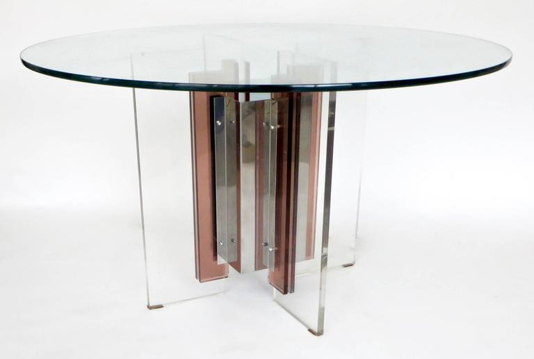 French dining or center table by the French Designer Philippe Jean, signed P Jean on the stainless steel. Shown by Galerie Eric and Xiane Germain, Paris, circa 1970. The galerie edited and showed various important French artists from the 1970s such