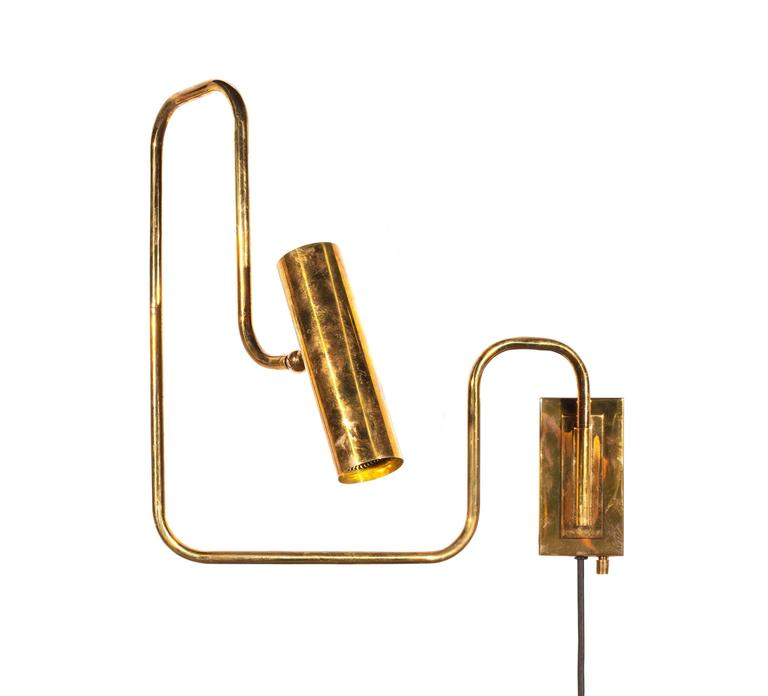Brass handmade pivot light wall sconce designed by Christopher Gentner.