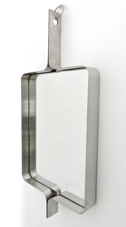 A Xavier-Feal French rectangular brushed stainless steel wall mirror, circa 1970. Produced by Inox Industrie, circa 1970. This mirror was previously attributed to Michel Boyer. A pair available. Will separate. Price listed is per mirror.  Excellent