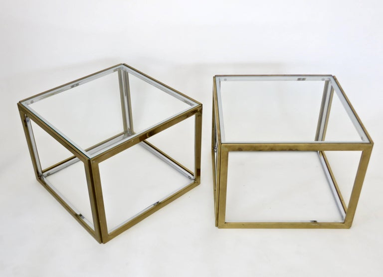 A pair of French square brass and chrome end or side tables with glass top by Maison Charles et Fils. Can easily be put together to use as a coffee table. This listing is for one pair.  Each square is 20