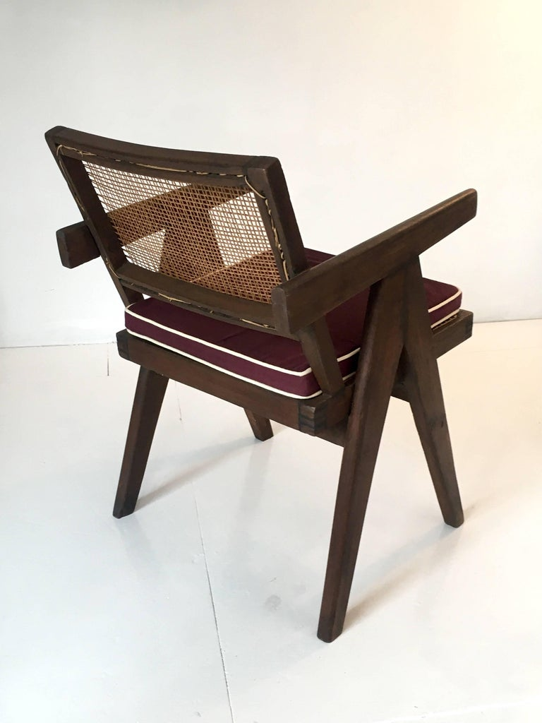 A single armchair called office cane chair by Pierre Jeanneret (1896-1967) from Chandigarh.