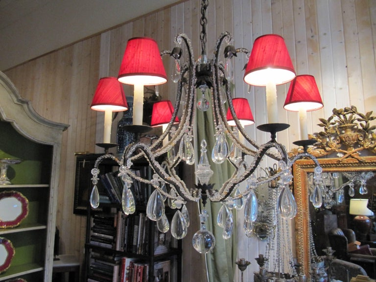 A beaded wrought iron six-light chandelier.