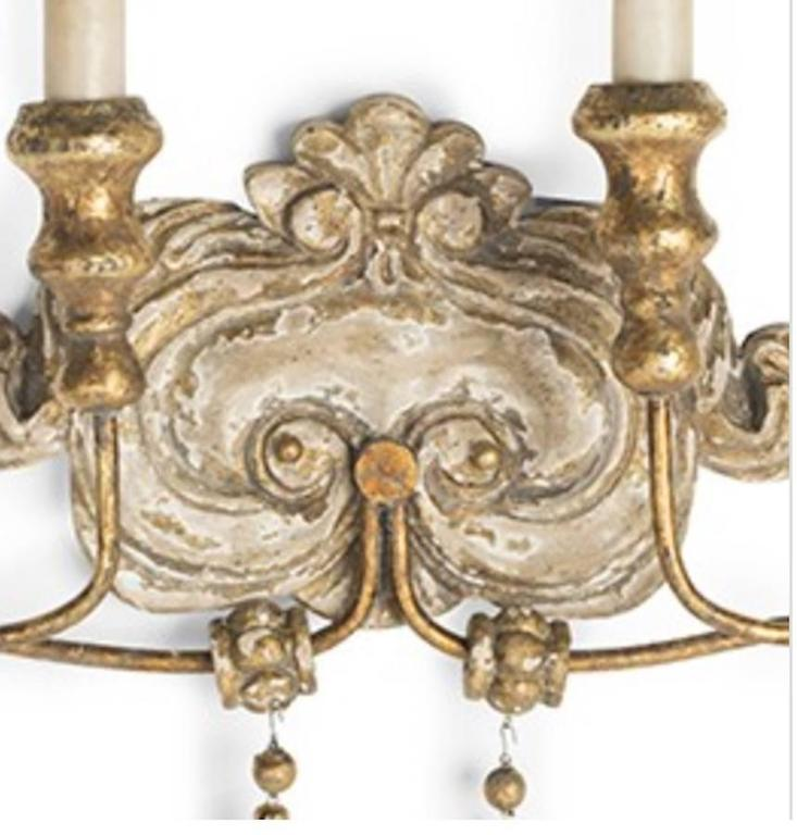 Elegant set of six Italian style two-arm sconces with lovely worn painted and gilt finish. Newly wired so installation ready. Note: Priced per sconce.