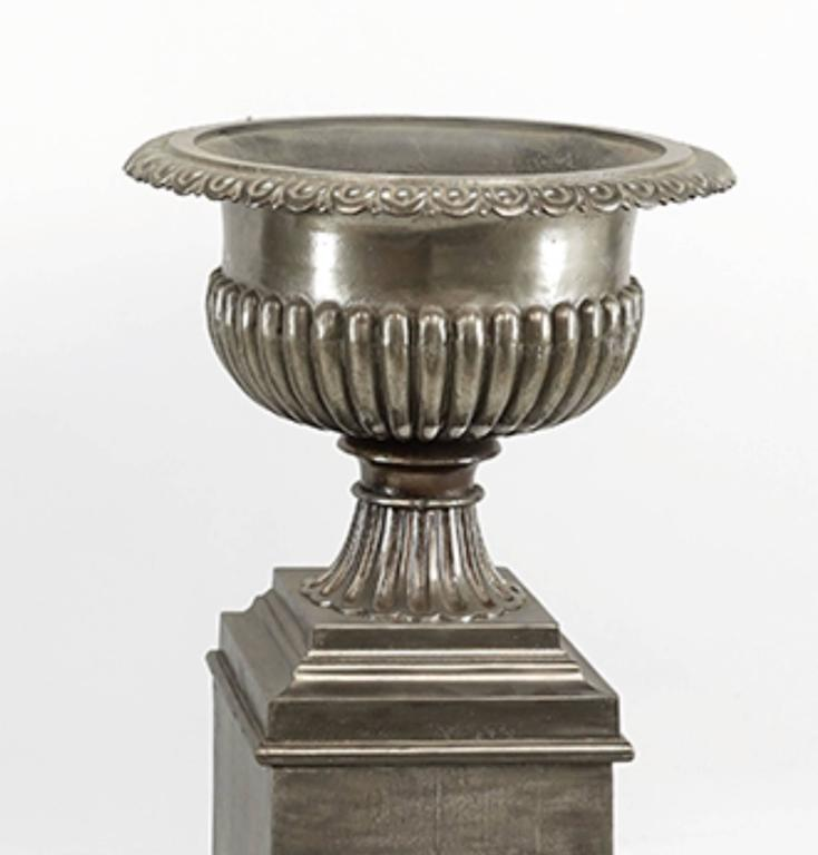 One pair very stately 19th century English urns on stands, brushed steel finish.