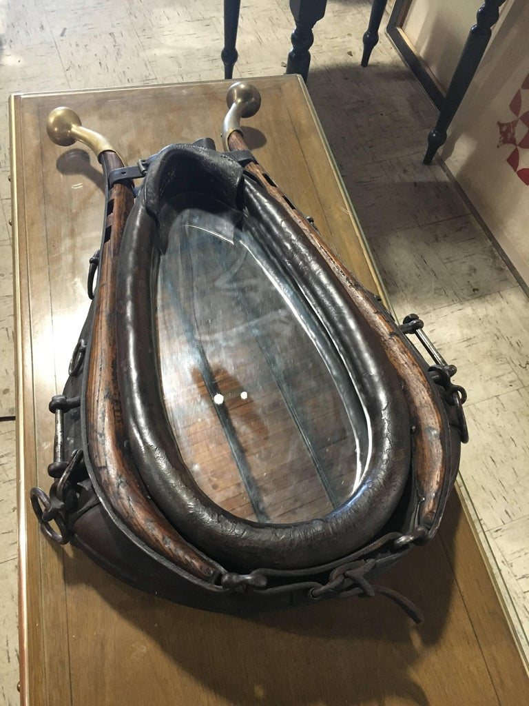 Handsome 19th century leather, wood and brass horse collar mounted as mirror.