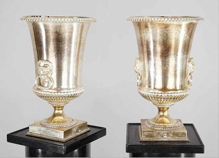 English One Pair Of Hollywood Regency Ebonized Fluted Columns With Silver Plate Uplight. For Sale