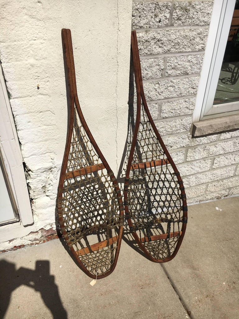 Handsome pair of 19th century snow shoes, great as wall sculpture.