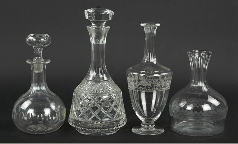 A Collection Of Ten Cut Glass Decanters Of Various Forms And Makers.  Comprising a near set of three and two others Tallest: 10.5""