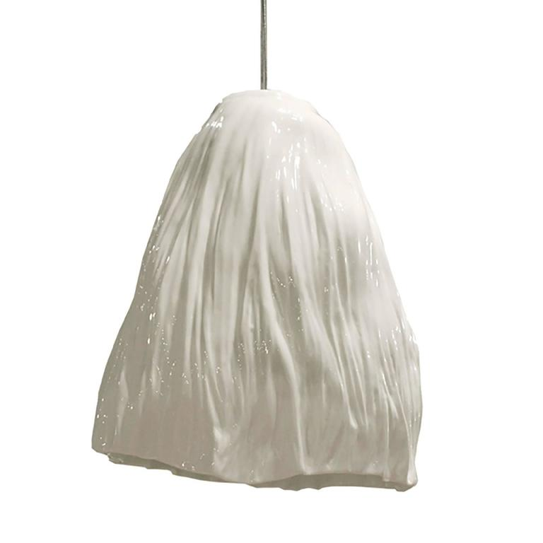 Xie Dong, a Beijing-based ceramist, works conceptually to capture moments of time in porcelain. Each SHUI pendant gracefully mimics draping fabric while maintaining the highest level of craftsmanship. The art of creating pure white porcelain, thin