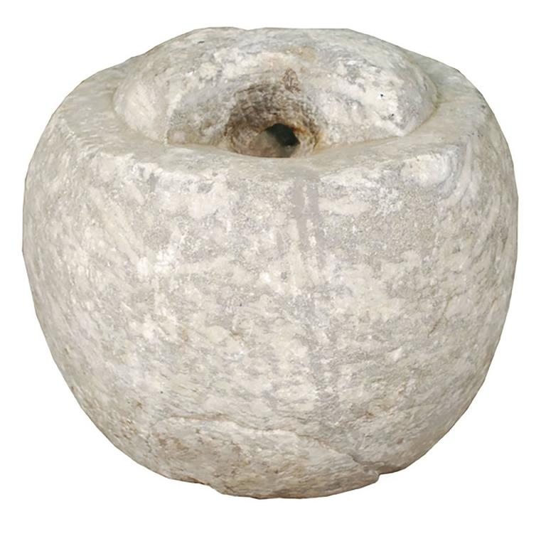 Unlike many objects of its kind, this limestone hitching stone was carved into a simple rounded shape without any figurative references. Used to secure a horse by rope or reins, the stone would have been found outside the home of a wealthy