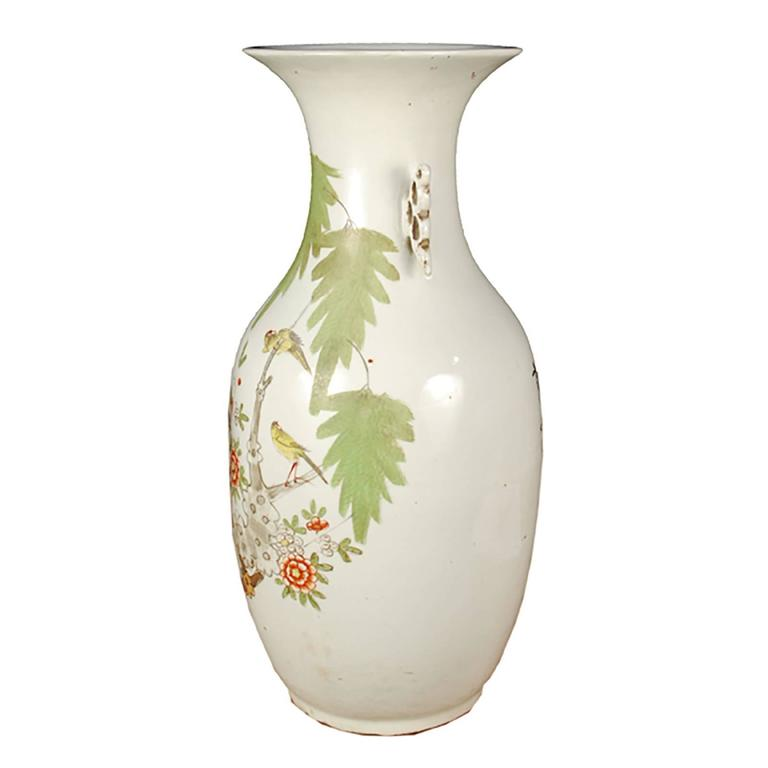 The Chinese phoenix tail form dates to the bronze age, but endured throughout the centuries until this version was fired in the early 20th century. Cherry blossoms and cranes adorn the creamy base glaze. As a symbol of springtime renewal and beauty,
