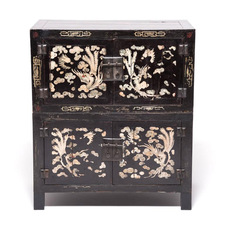 This pair, comprised of four petite 19th century chests from Shanxi, China, are incredibly modern in terms of their modularity and can be used in multiple configurations. The original lacquer & painting has mellowed beautifully over time. The