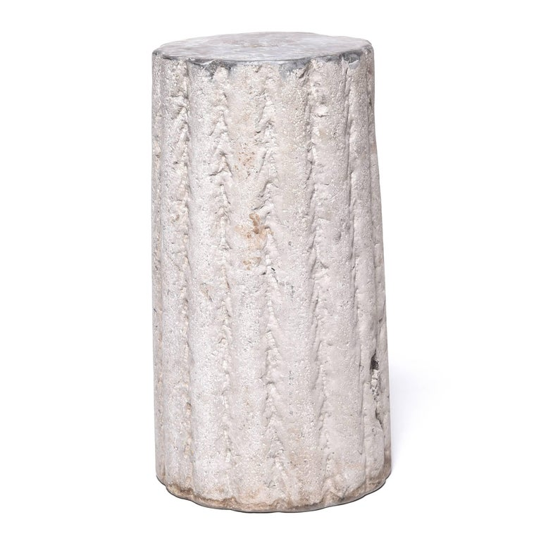 With its textured and ribbed surface this hand-carved stone once ground grain and nuts at a Hebei province wind- or watermill. Over a hundred years old, the stone's surface has worn down through use, leaving only a hint of its original texture. A