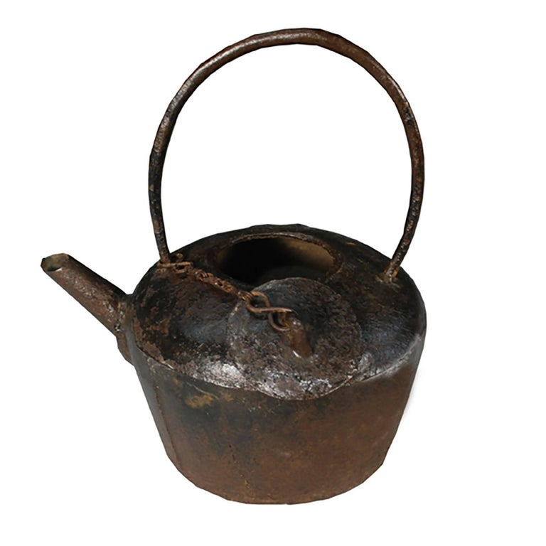 This sculptural iron teapot was cast in Northern China during the early 20th century. Before tea became a popular drink, it was used medicinally to prevent many different diseases. A 16th century Chinese medical book describes tea as a remedy for