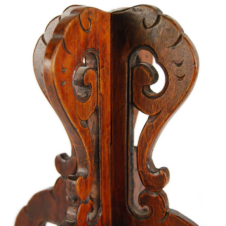 Out of context, this carved wood hat stand has a curious, octopus-like appearance. Intricately embellished with carved flourishes, the hat Stand displays the opulence of court fashion, where rank and status was expressed through fashion and its