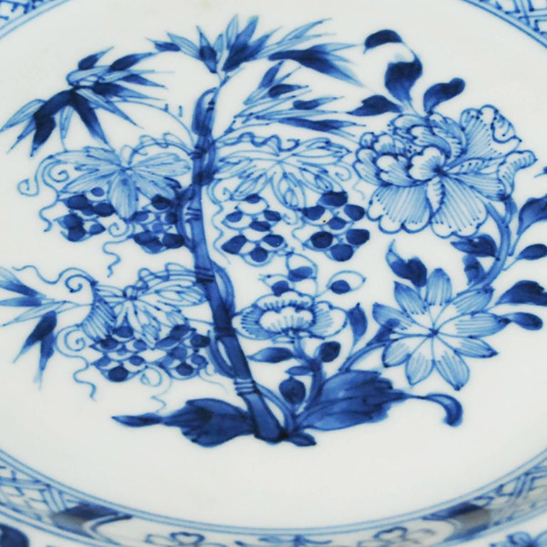 By the 19th century, Chinese painted porcelains were sought after the world over. This hand-painted plate, decorated with an intricate floral pattern in the famous blue-and-white design, was produced in China, for export to Europe.