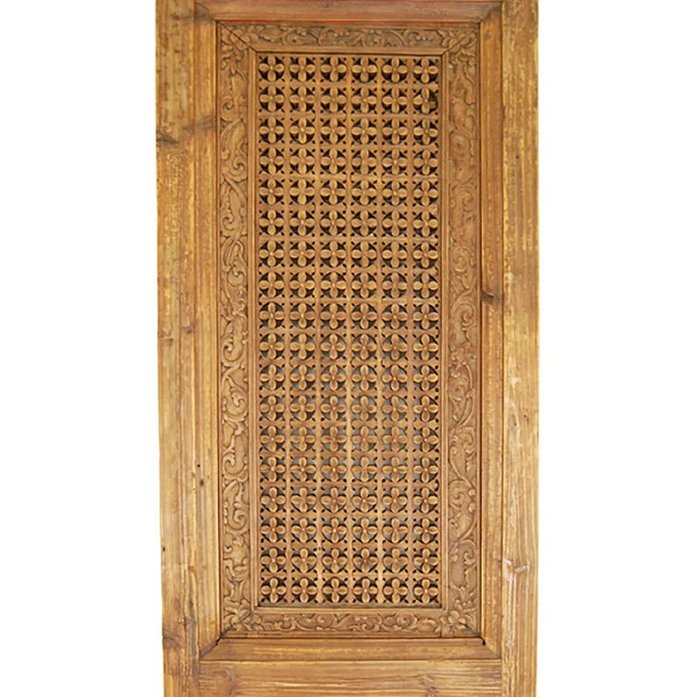 This pair of 19th century Chinese doors evokes life in an aristocratic Chinese courtyard home. Creating this tight floral lattice pattern was like putting a puzzle together; very different from making fretwork by carving or perforating a solid
