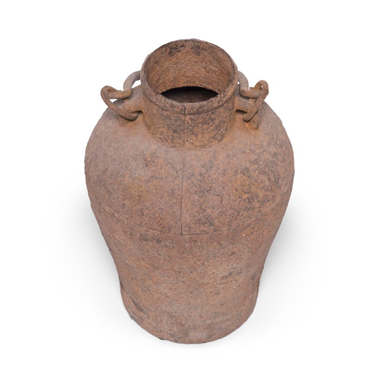 This cast-iron vessel has an elegant form reminiscent of the beautiful ironwork, bronzes, and ceramics perfected by Chinese artisans thousands of years ago. A century ago this jar would have been purely utilitarian, but over time, as the iron has