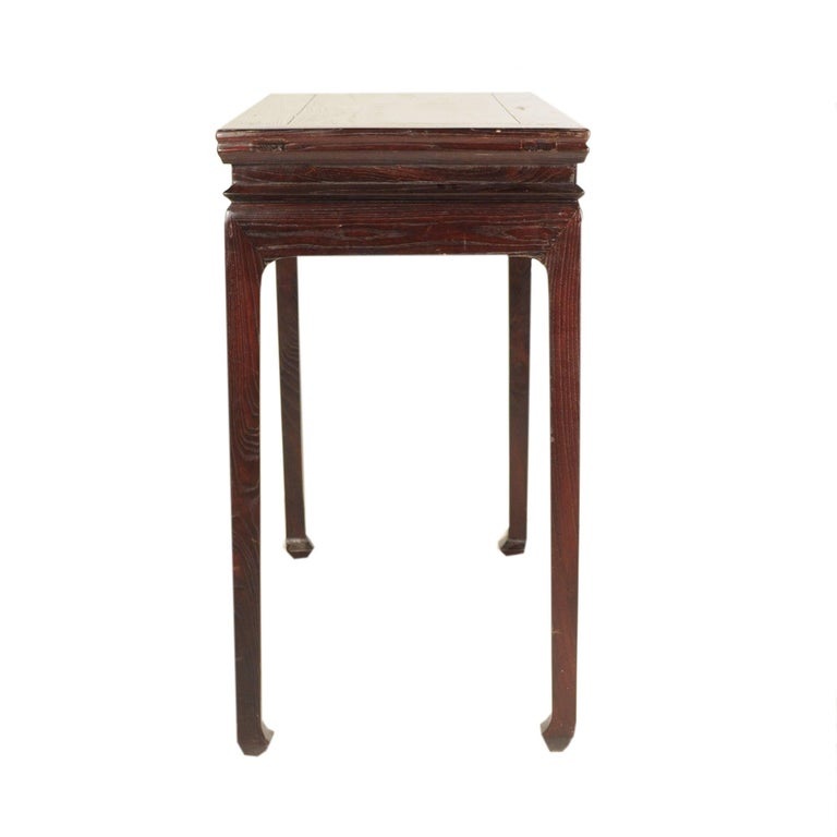 Chinese rice wine-making practices extend over 4,500 years into the past. Furniture-makers responded by designing and creating the perfect tables for sharing wine with family and friends. This 19th-century elmwood example is high waisted with gently