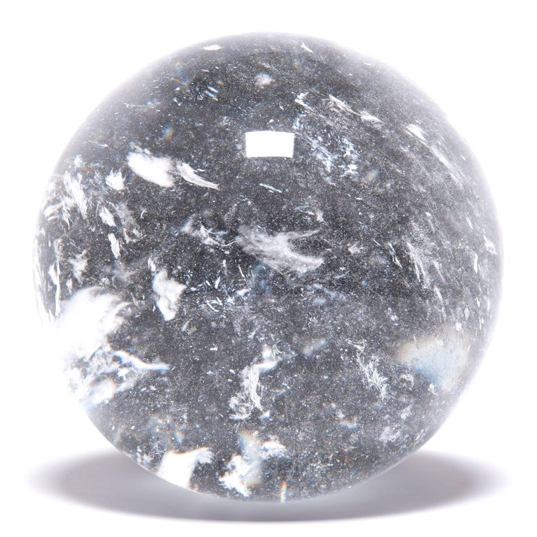 Polished Chinese Crystal Sphere with Occlusions For Sale
