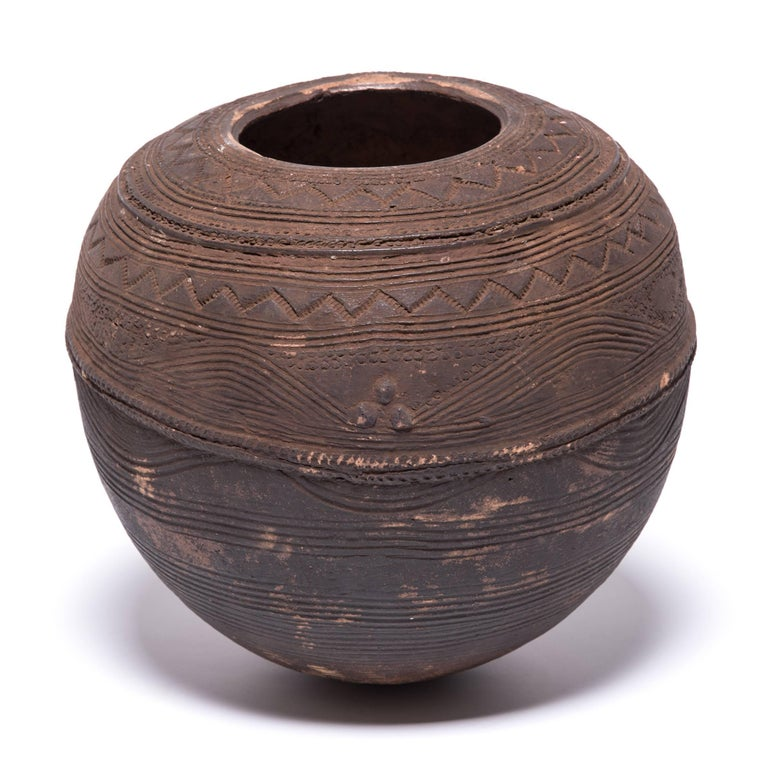 The Nupe people of Nigeria were touted as some of the finest ceramicists in Africa. Everyday objects, like this water vessel received detailed attention. The vessel's varied textures are an integral part of its utilitarian design. The patterns and