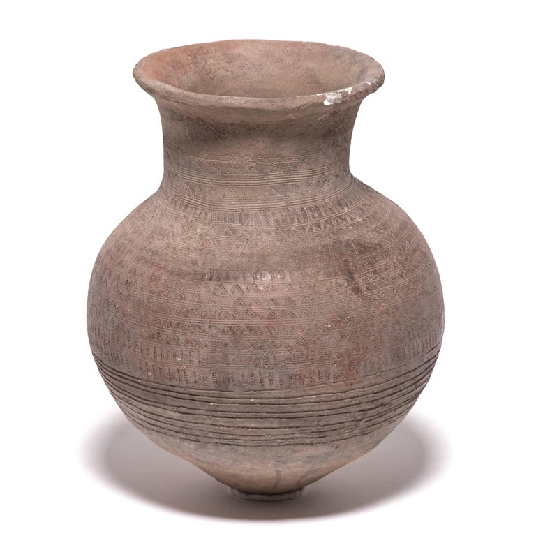 The Nupe people of Nigeria were known as some of the finest ceramicists in Africa. Everyday objects, like this water vessel, received detailed attention. The vessel's varied textures come from its functional design. The dimples and bands were