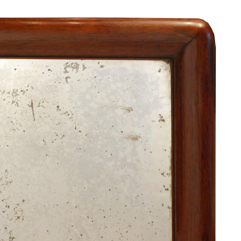 Trimmed in rich rosewood, this hand mirrored glass tray has an ethereal look perfectly in line with its former use as an opium tray. Dating from the mid-19th century at the height of opium use in China, the tray was used to corral the exquisitely