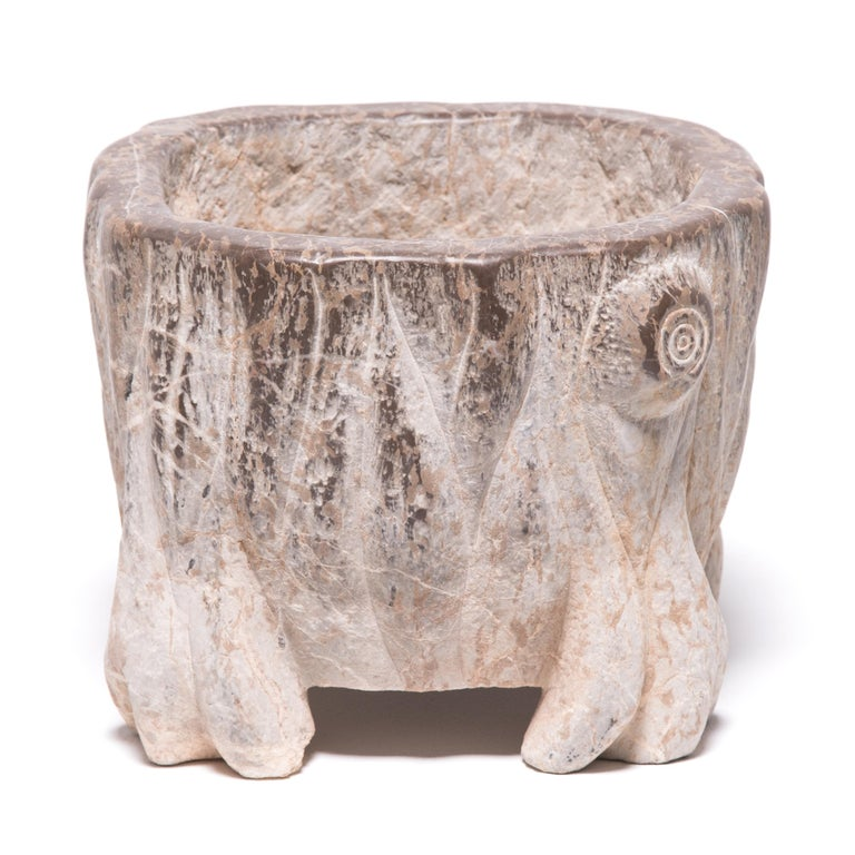 The artisan who carved this pair of petite basins skilfully called out the stone's natural veining by delicately tracing the markings with carved vertical lines and shaping with subtle curves. The unusual feet suggest the paws of an animal or roots,