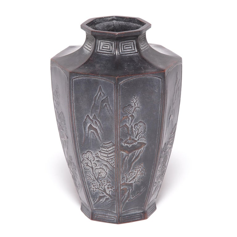Traditional Japanese metalworkers are renowned for creating specialized alloys that elevated the art of refining, molding, and casting metals. An alloy of zinc and copper gives this octagonal vase its rich dark color, intricately decorated with