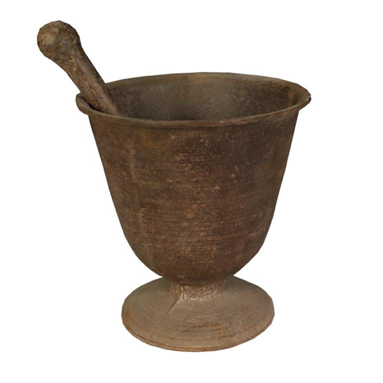 Since ancient times, apothecaries around the world have been using mortar and pestles like this one to grind medicinal herbs. This finely crafted and sculptural vessel was cast in iron in the early 1900s and would have been indispensable to a Korean