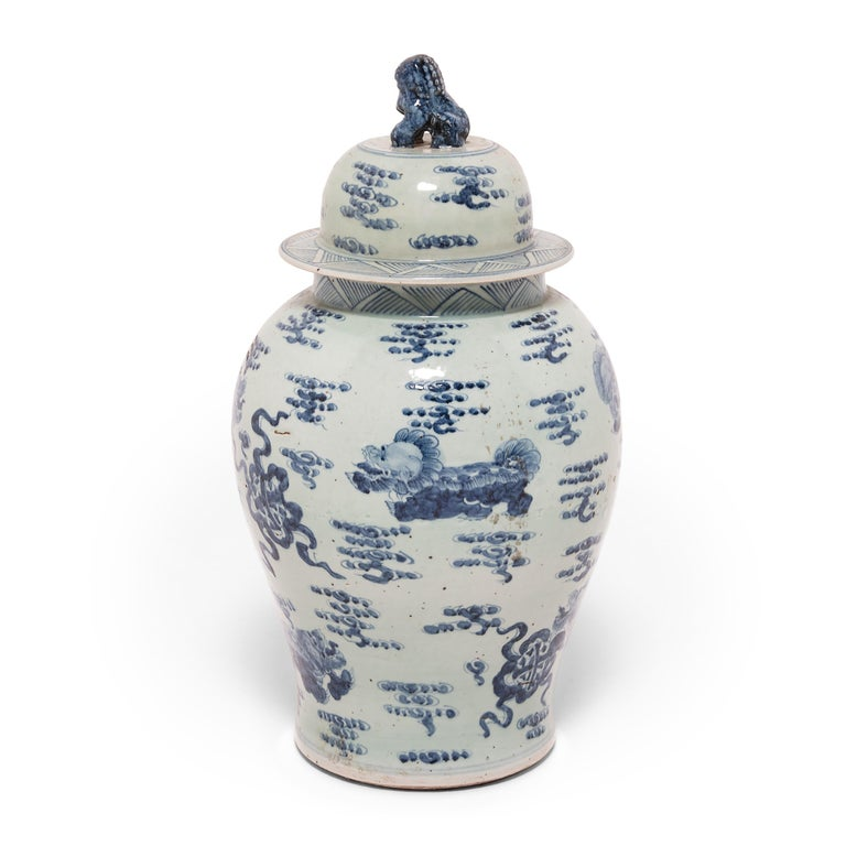 Images of shizi, a lion-dog symbol of power and strength of character, cavort among the stylized clouds of heaven on this hand-painted covered jar. Originally intended for storing spices, this jar is a beautiful example of traditional Chinese